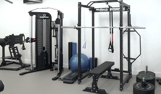 Squat rack, functional trainer and glute ham raise in the Paramount Physiotherapy gym.